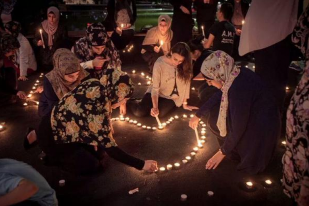 Muslim youth unite with other faiths to light a vigil for victims of hostage taker, Man Haron Monis, in Sydney. (Twitter/@mina_ysf)