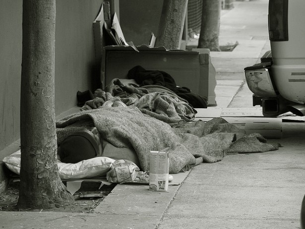 Homeless people sleeping on the sidewalk in San Francisco. (Flickr/Franco Folini)