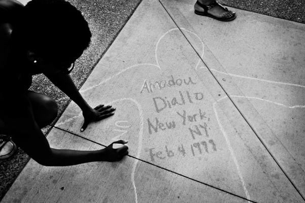 An outline of a body with the name of Amadou Diallo is drawn at Washington University as part of #chalkunarmed. (Twitter/Laken Sylvander)