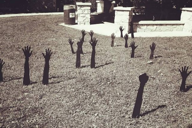 "A ""Hands Up"" installation by Basil Kincaid planted along main streets in Ferguson. (heartacheandpaint.com)"