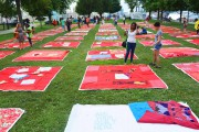 Monument Quilt laid out crowd-sourced quilts with messages about domestic violence or sexual assault in Baltimore in August 2014. (Monument Quilt)