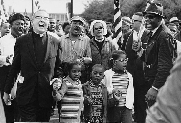 The Selma to Montgomery marchers arrive in Montgomery. At center are Martin Luther and Coretta Scott King, with Ralph Abernathy's three children. (Wikipedia / Abernathy Family Photos)