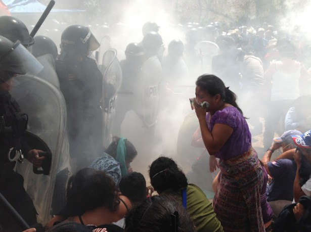 Guatemalan National Police use tear gas and batons against the community activists to clear a route for the machinery for the El Tamblor Mine. (Guatemalan Human Rights Commission)