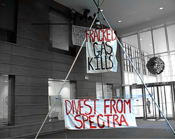 Activists shut down Spectra Energy's Waltham office after deploying a 24-foot tall tripod. (FANG)