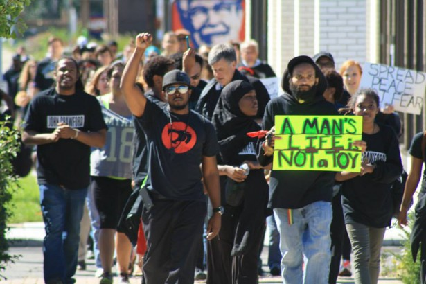 The Ohio Student Association organized an 11-mile march from the Walmart where John Crawford was killed to the Beavercreek police station on September 25. (Facebook)