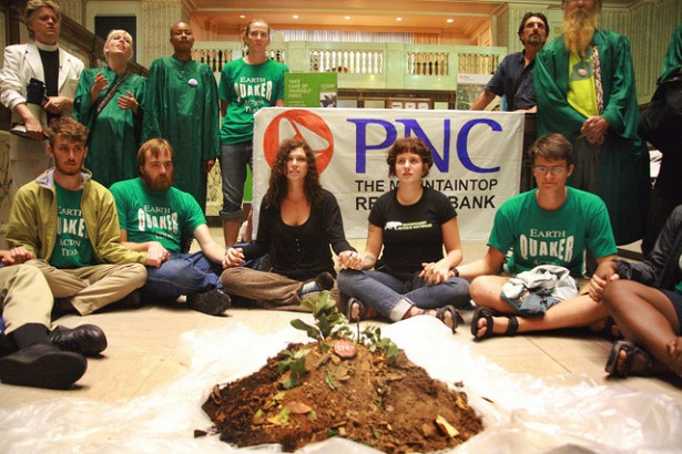 "Rainforest Action Network, Reverend Billy and the Life After Shopping Choir, and EQAT performed a ""bring the mountain back to PNC Bank"" action to ask PNC to stop supporting mountaintop removal coal mining. (Flickr/ Brennan Cavanaugh)"