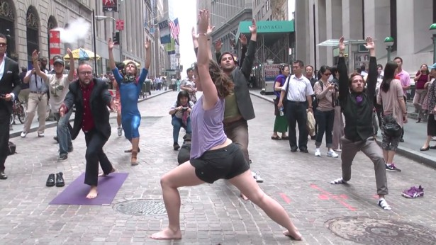 Activists doing yoga in the financial district two weeks before Occupy Wall Street, as a test run for their claiming of public space. (WNV / Karsten Braaten)