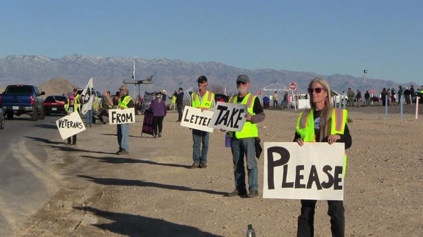 Protesters hold signs about the letter to drone pilots from Veterans for Peace. (Facebook/Julie Brown)