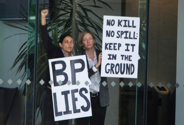 Gulf Coast residents Cherri Foytlin and Anne Rolfes occupying BP headquarters in Houston yesterday.(Flickr / RAN / Matthew Kerkstra)
