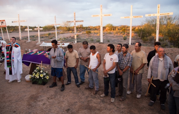(Father Priscilliano Peraza leads a sermon blessing 20 men who will soon continue their migration through the Sonoran desert to the United States. (Left in Focus/Bryan MacCormack)
