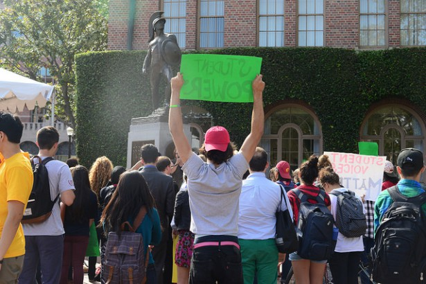 "A USC student holds a sign reading ""Student Power"" at a protest on campus last year. (Flickr / Dale Chong)"