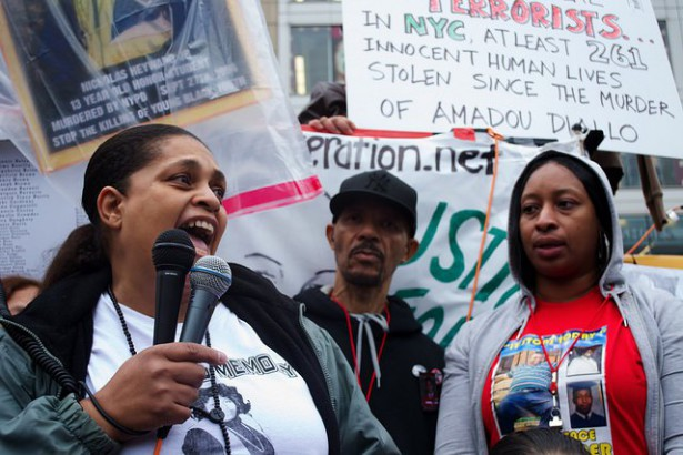 Cynthia Howell, niece of Alberta Spruill, speaks on the National Day of Protest to Stop Police Brutality. Next to her is Nicholas Heyward, Sr., father of Nicholas Heyward, Jr. and Lisha Garner Flagg, sister of Eric Garner. October 22, 2014. (Families United 4 Justice)