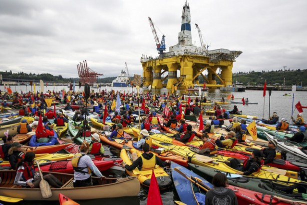 Kayak-tivists gathered in Elliott Bay on Saturday, May 16, where the Polar Pioneer drilling rig is docked. (Flickr / Backbone Campaign)