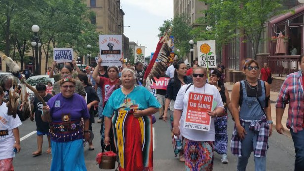 Native women carrying sacred water led a climate march against Big Oil pipelines in St. Paul, Minnesota on June 6. (WNV / David Goodner)
