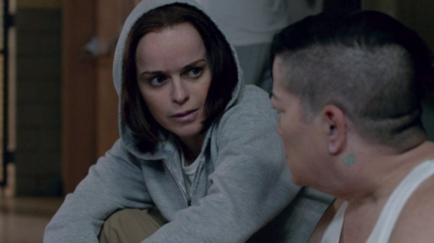 "Tiffany ""Pennsatucky"" Doggett talks with Carrie ""Boo"" Black during the third-season finale of ""Orange Is the New Black."" (Netflix)"