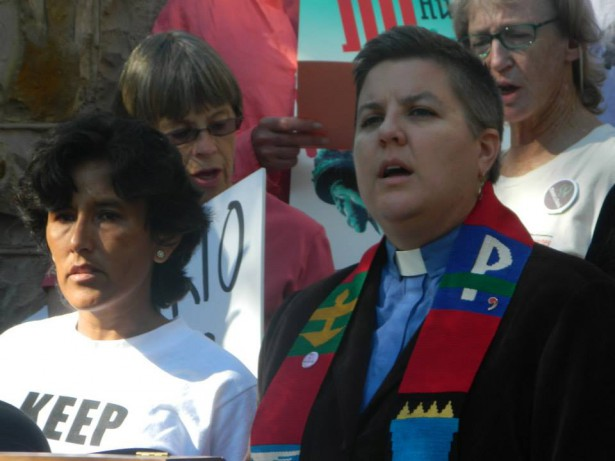 Leading singing at the launch of the Metro Denver Sanctuary Coalition, September 2014. (WNV/Anne Dunlap)
