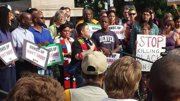 Invoking the presence of Dr. Vincent Harding, National Moment of Silence vigil in August 2014. (WNV/Anne Dunlap)