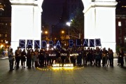 The NYC Light Brigade and dozens of supporters gathered near the arch in Washington Square Park and held up Sandra Bland's name. (WNV/Ashoka Jegroo)