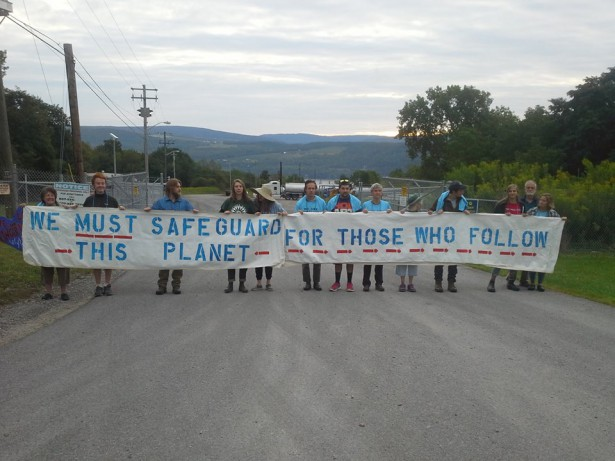 Students from five colleges helped hold the banner blocking Crestwood's gates. (Facebook / We Are Seneca Lake)