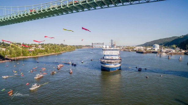 Greenpeace activists formed a human net below Portland's St. Johns Bridge to stop the Shell Oil icebreaker Fennica from leaving to support drilling operations in the Arctic. (Flickr / Twelvizm)
