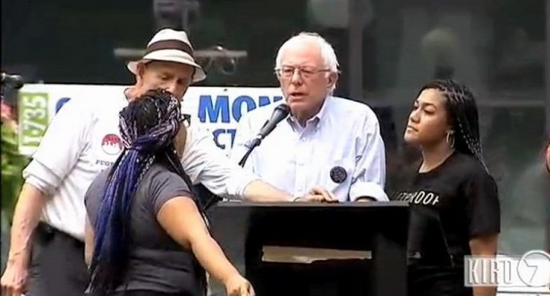 Activists Marissa Janae Johnson, left, and Mara Jacqeline Willaford interrupt Sanders in Seattle (Brandon Wall/Twitter)