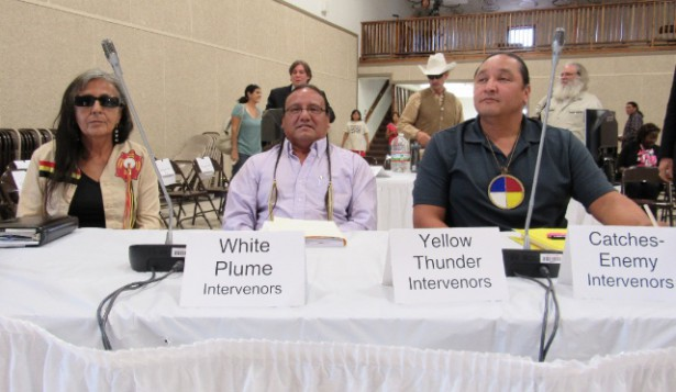 Debra White Plume (with Lakota cultural experts) prepares to testify at the Nuclear Regulatory Commissions' hearings.