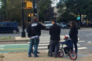 A PROP member issues a summons to a Brooklyn family. (WNV / Ashoka Jegroo)