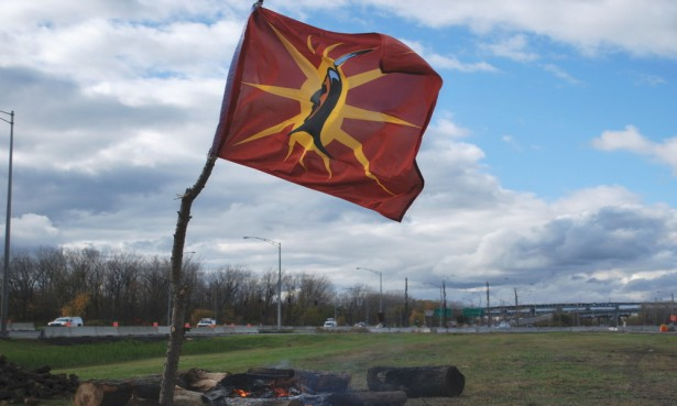 The Mohawk warrior flag flying next to the bonfire. (Red Power Media)