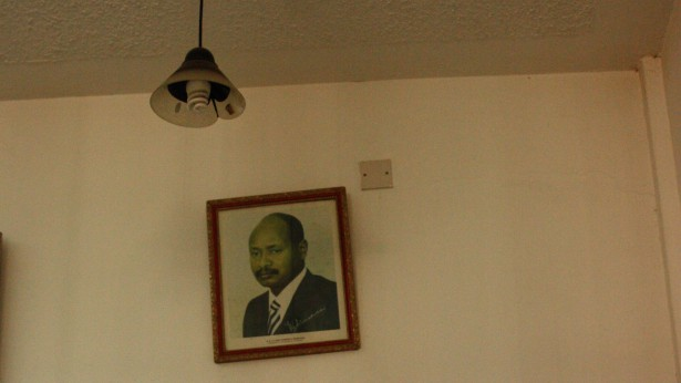 A photo of Ugandan President Yoweri Museveni watches over a hotel business center in Entebbe. (Privacy International)