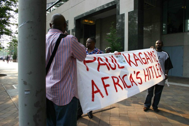 Rwandan activists unfurl a banner against President Paul Kagame. (Flickr)