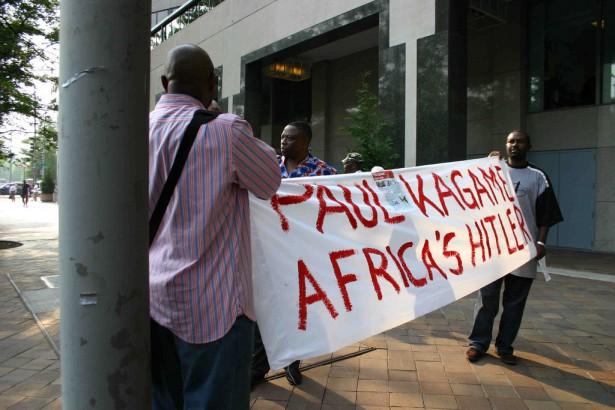 Rwandan activists unfurl a banner against President Paul Kagame. (Flickr)