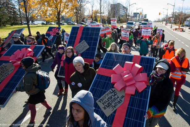 A group of citizens walks down Sussex Drive in Ottowa to delivery solar panels to Justin Trudeau's home during Day 4 of the Climate Welcome. (Survival Media Agency / Robert van Waarden)
