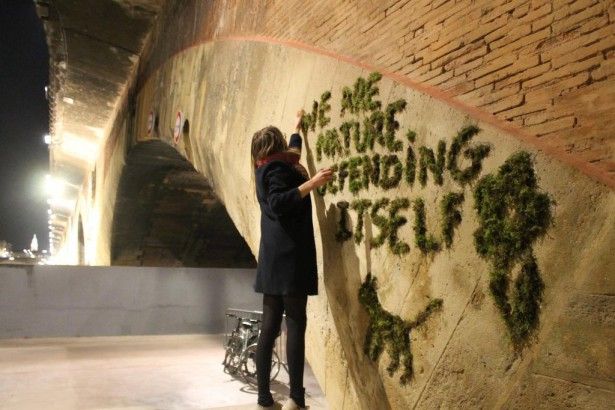 An activist makes moss graffiti in Paris with the slogan of the Climate Games. (Twitter/@JEBA_JE)
