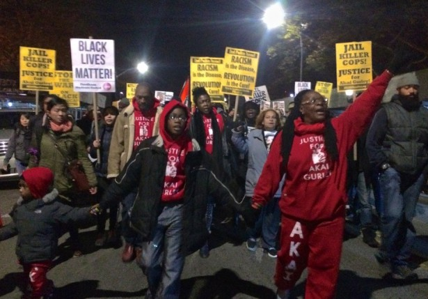Akai Gurley's family lead a march for justice on the anniversary of his death. (WNV/Ashoka Jegroo)