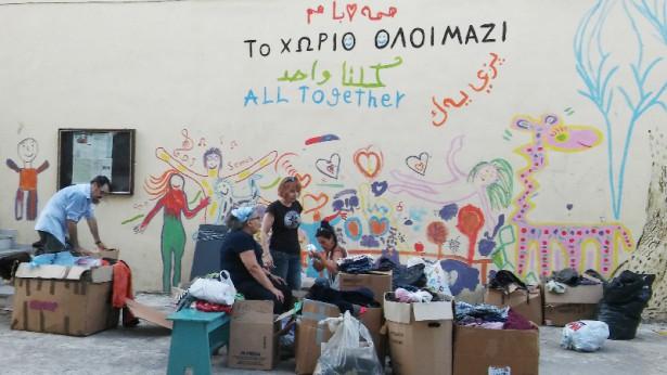 Volunteers at Pikpa pack goods for refugees. (WNV / Tom Leonard)
