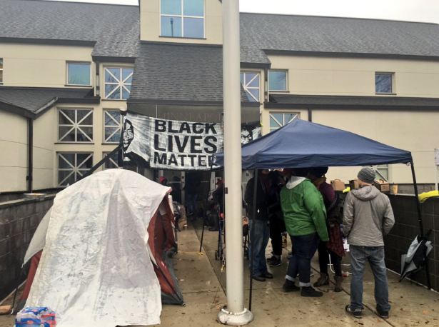 Activists set up tents outside the Fourth Precinct. (Twitter / @webster)