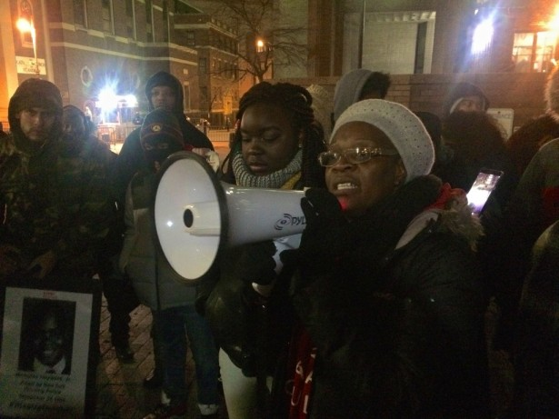 Akai Gurley's aunt speaks to a crowd outside the NYPD's headquarters on Friday after the conviction of officer Peter Liang. (WNV / Ashoka Jegroo)