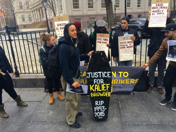 An activists holds a mock coffin for Kalief Browder outside City Hall in New York City on Feb. 23. (WNV/Ashoka Jegroo)