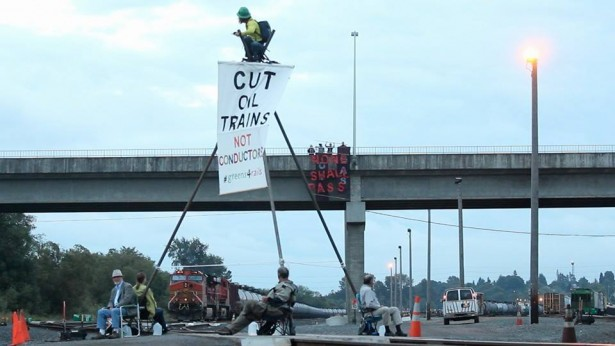 Rising Tide Seattle activists have blockaded an oil train in Everett. (Facebook / Rising Tide Seattle)