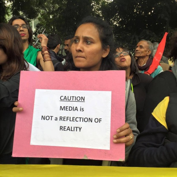 A woman holds a sign critical of the media at the march on Feb. 18. (Facebook/Stand With JNU)