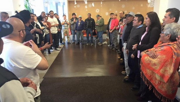 "Delfino Leadership Institute participants gather for a final ""unity is power"" chant to welcome in new worker-leaders on March 12. (Facebook/New York Worker Center Federation)"