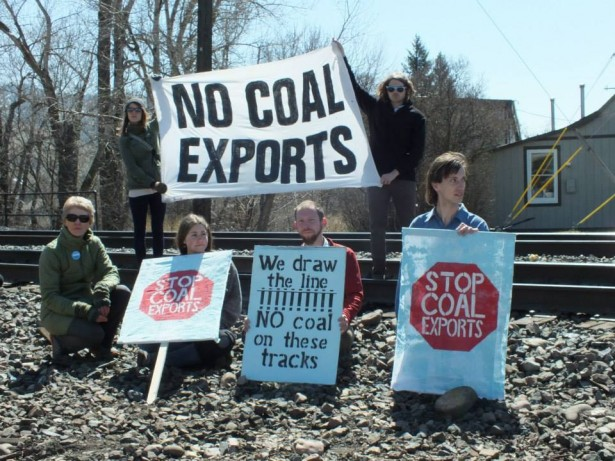 Activists protesting on the train tracks in April 2014. (Blue Skies Campaign)