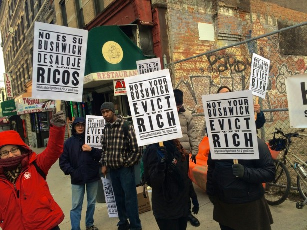 Members of the Brooklyn Solidarity Network protest outside a lot in Bushwick, where a luxury development is being planned. (WNV/Ashoka Jegroo)