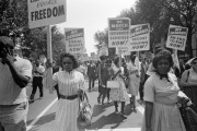 A group of women holding signs during the March on Washington in 1963.
