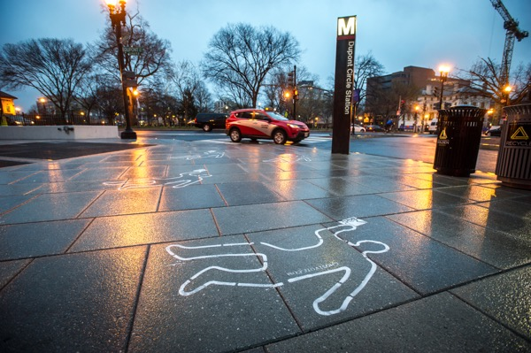 Chalk outlines of victim of gun violence, like this one near the Dupont Circle metro stop, were made around Washington, D.C. as part of the Ghost Vote campaign. (States United to Prevent Gun Violence)