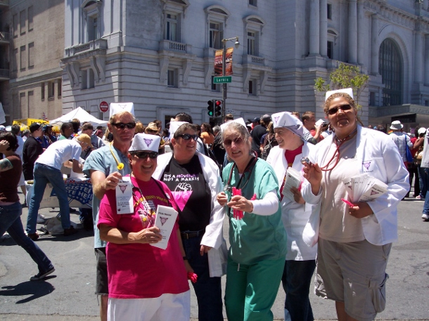 Daniel Ward, Deni Asnis, Deeg Gold, Tory Becker, Kate Raphael and Cynthia Wright distribute promotional materials for LAGAI's farcical HMO, Pink Shield (aka FruitCare) at San Francisco Gay Pride, June 2007 (WNV/Deeg Gold)
