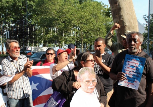 Activists gathered outside the United Nations on June 20. Ana Lopez (center) is holding a cardboard cutout of Lopez Rivera. To her left is Puerto Rican former political prisoner Adolfo Matos, and to her right is former Black Panther political prisoner Tariq Haskins. (WNV / Carlos Silva)
