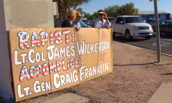 the family of a sexual assault victim and Protect Our Defenders protested outside an Air Force Base in Arizona on April 25, 2013. (Protect Our Defenders)
