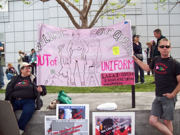 """Deeg Gold and Daniel Ward hold a """"We Like Our Queers Out Of Uniform"""" banner at an anti-military demonstration in San Francisco, March 2010. (WNV/Tory Becker)"""