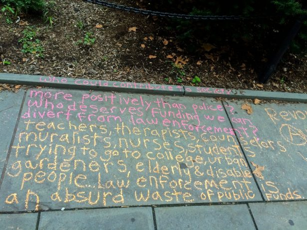 A message written in chalk outside of City Hall in New York City. (Ashoka Jegroo)